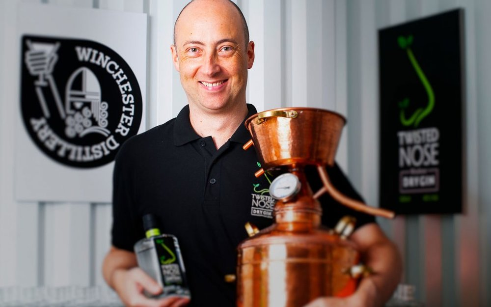 Winchester Distillery founder Paul Bowler and the original still used to make his now famous gin