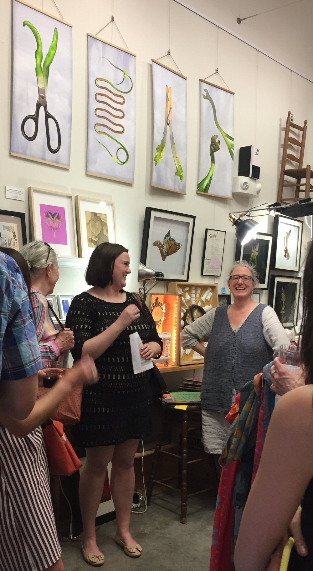 "Rachel Burley (left) and artist Leda Black (right) speak about Black's ""Female Power Project."""