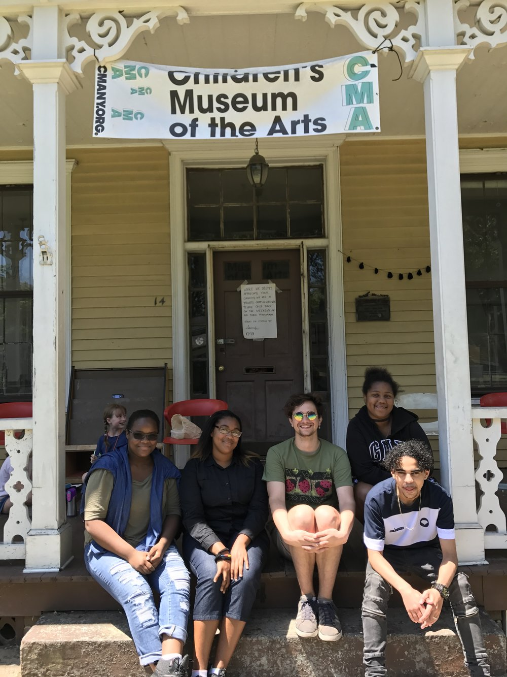 MECA interns at their summer job at the Children's Museum of Art, August 2017