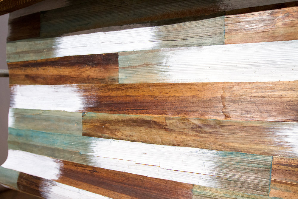 """Wallpaper"" made from thin pieces of recovered wood."