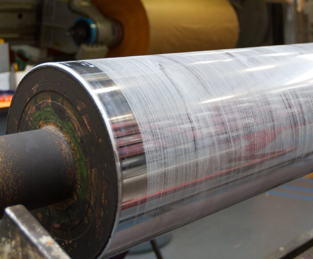 - Once the client has approved the design concept, rotogravure cylinder are laser engraved for each stage of the décor print. A woodgrain design may have three, four or five print stages.