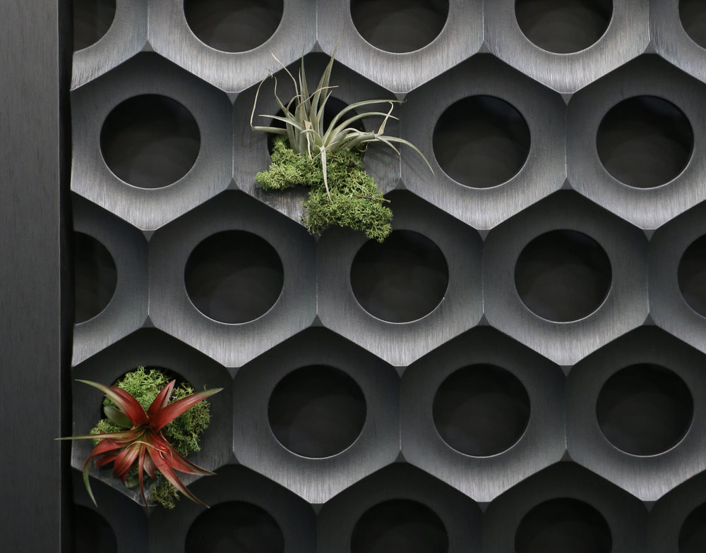 3D textured wall panel feature OMNOVA's  Jazz Silk  design.