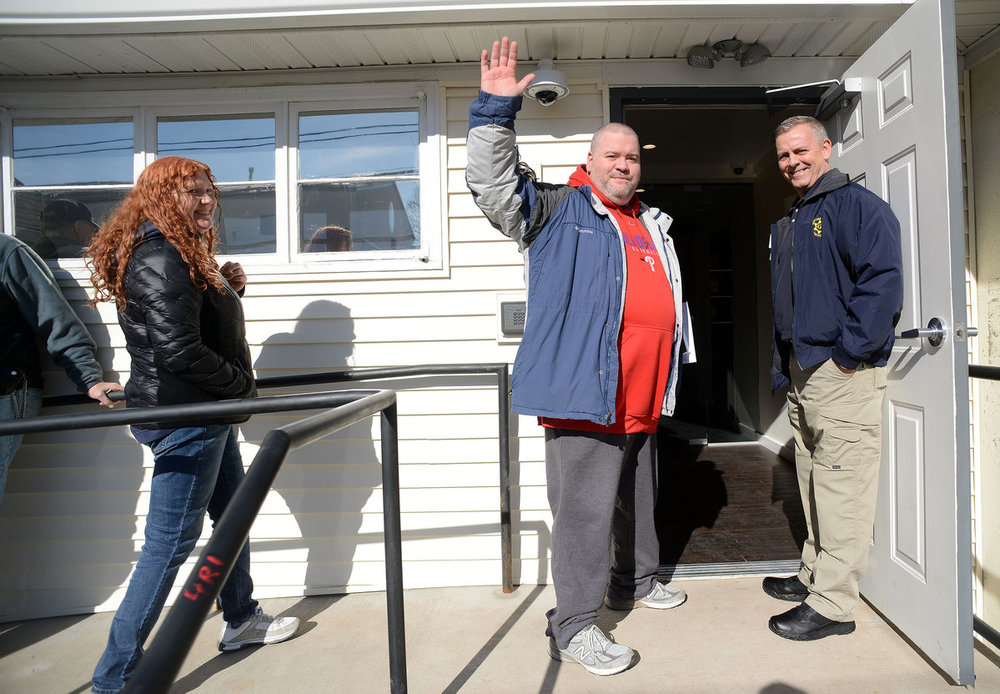 Thom Shannon waves as he is allowed in for his appointment at TerraVida Holistic Center in Sellersville.