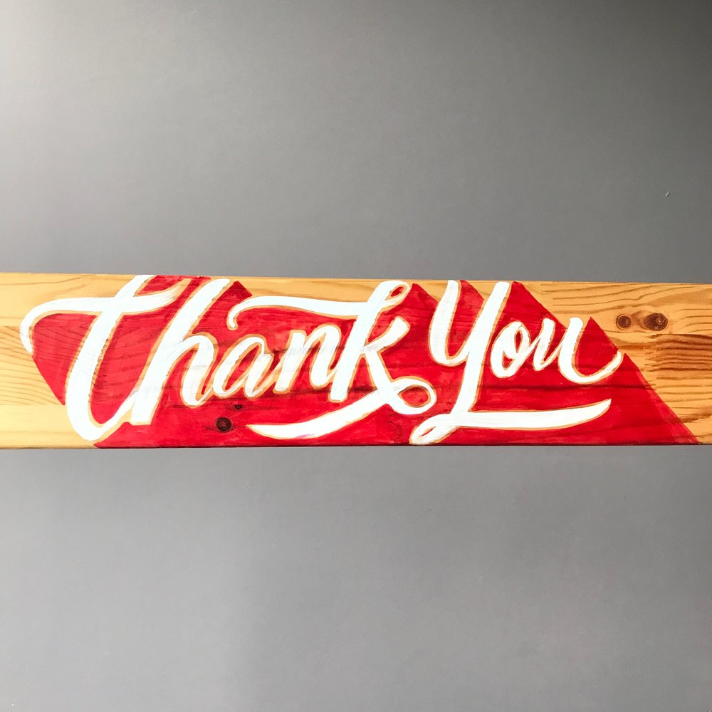 Thank You sign painted on wooden board