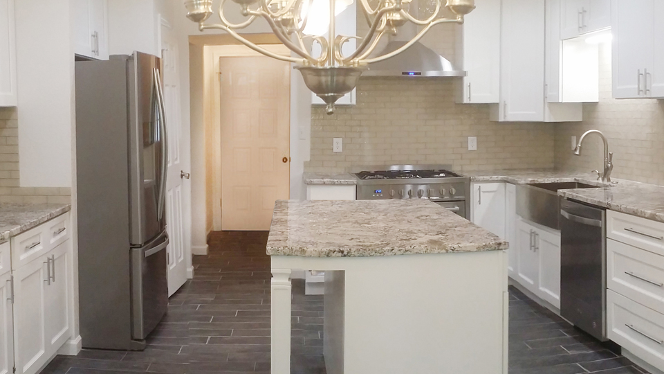 Remodeling - Totally remodeled with new floor, countertops, fixtures, and cabinets.