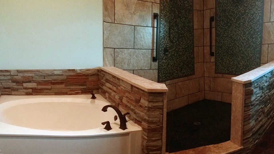 Garden Tub Remodel  - New tub, fixtures, custom shower, tile and stonework .
