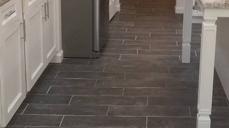 Tile  - Beautiful new kitchen floor installation.