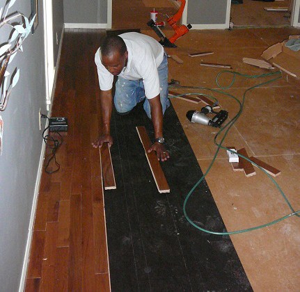 Bina installing hardwood flooring