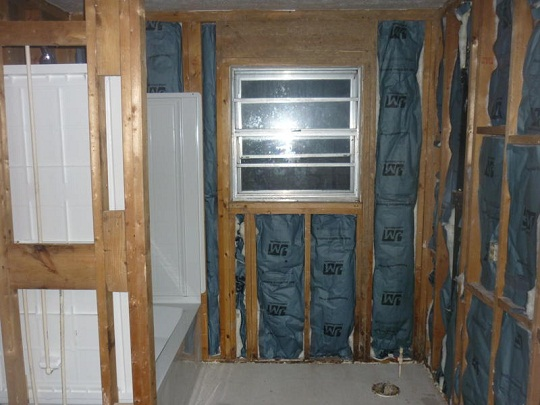 Studs, insulation and shower unit installed
