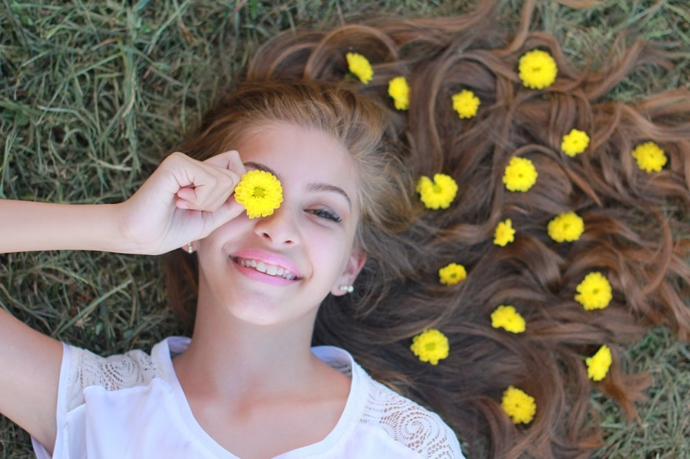 Teenaged girl lying on grass