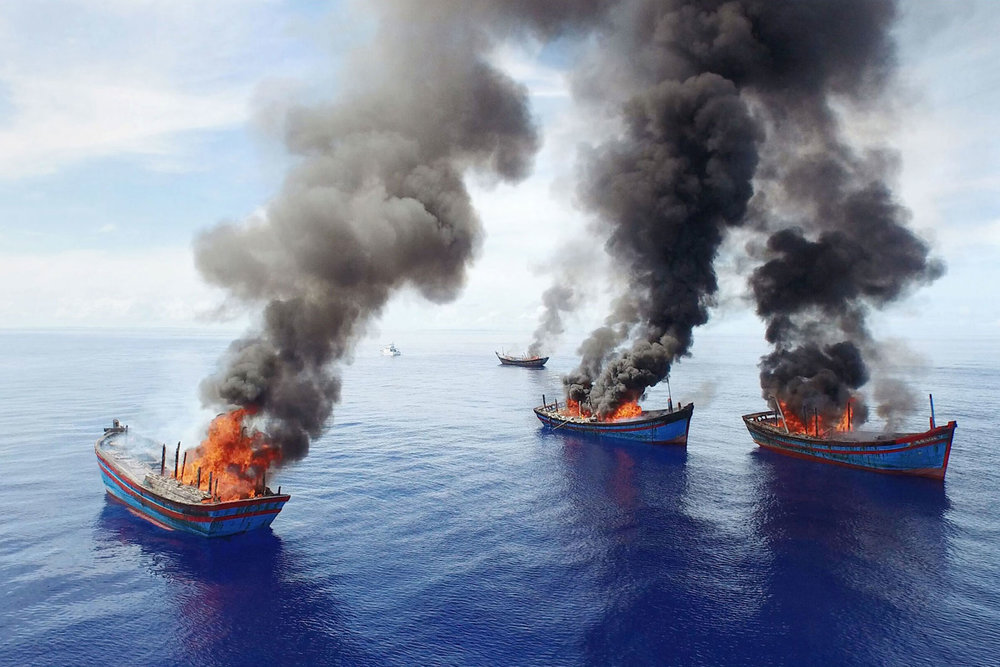 Palau authorities torched pirate fishing boats apprehended in protected waters.  (Pew Charitable Trusts photo)