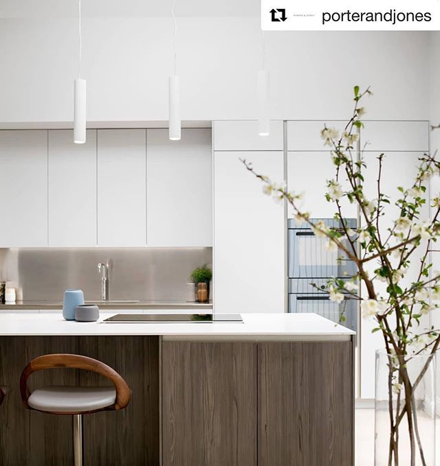 Another shot of this beautiful kitchen space we completed in collaboration with @porterandjones #Repost @porterandjones ・・・ It's not often we get to use a beautiful Tundra Elm finish on our bespoke cabinetry but this island works so well against the pearl grey matte lacquer cabinet backdrop. It is finished with a stainless steel worktop and backsplash for a clean, modern look feels anything but stark in this beautiful, light-drenched space. #WeArePorterAndJones