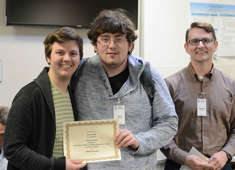 Winning the Second Place Poster Competition   Left to right: Jacob Poteet, Chris Persinger, Dr. Roger Wolbert