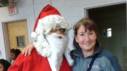 And here am I at a Zonta Christmas program for women' and children' residents of a DV shelter.