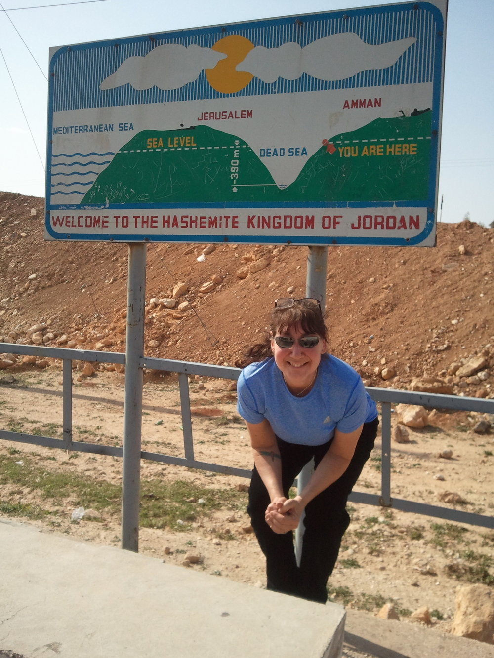 Pam in front of Dead Sea sign.jpg