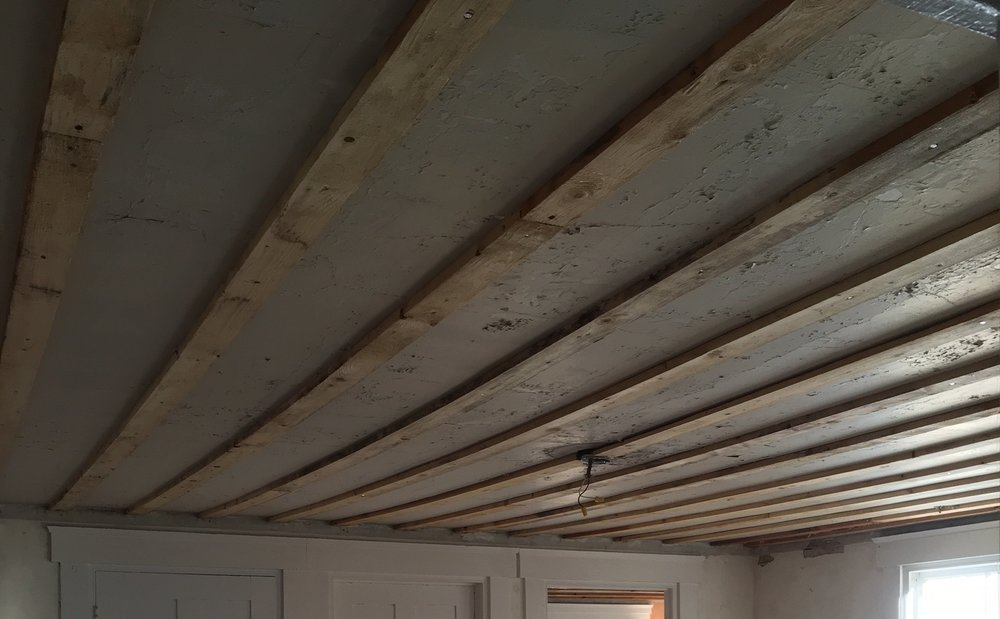 This old wood strapping is actually quite handy and saving us a lot of work (aka money) so it will stay and the new Sheetrock will be attached to the wood.