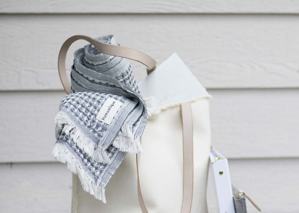 the  getaway gift capsule  includes a suna throw by hamamlique. it can be used as a scarf, throw, or towel. all moms love a good multi-purpose piece!