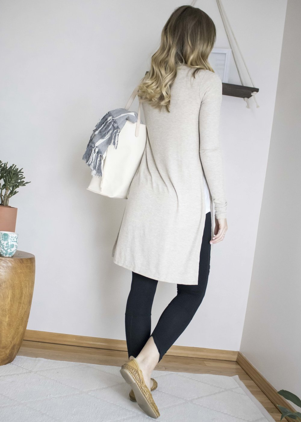 while wearing leggings, most of us to prefer covering our backsides... that's why we chose to offer this longer style of cardigan. it's a great staple for pairing with other fitted pants and also wears well with spring and summer dresses.