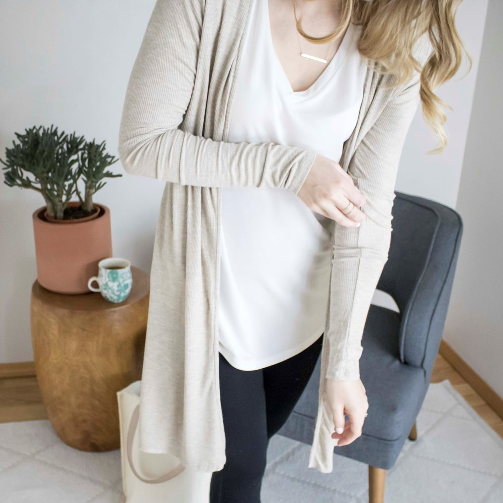 this lightweight, neutral cardigan is an all seasons staple for any capsule wardrobe. it's fitted yet flowy, long while also flattering, and can be worn casually or more formal. -