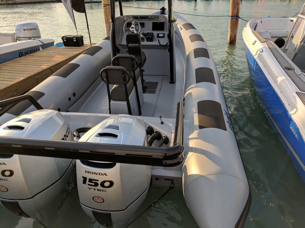 This is the kind of junk you expect to see these heavy slugs on. That's over 1,000 Lbs of outboard for 300 HP. I hate RIBs too. You probably need the inflation to keep this tug floating though. I hear Honda makes good lawnmowers.