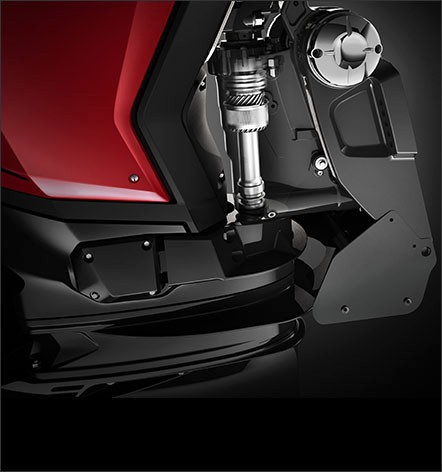 Integrated - Evinrude G2 Steering integrated right in the swivel bracket.