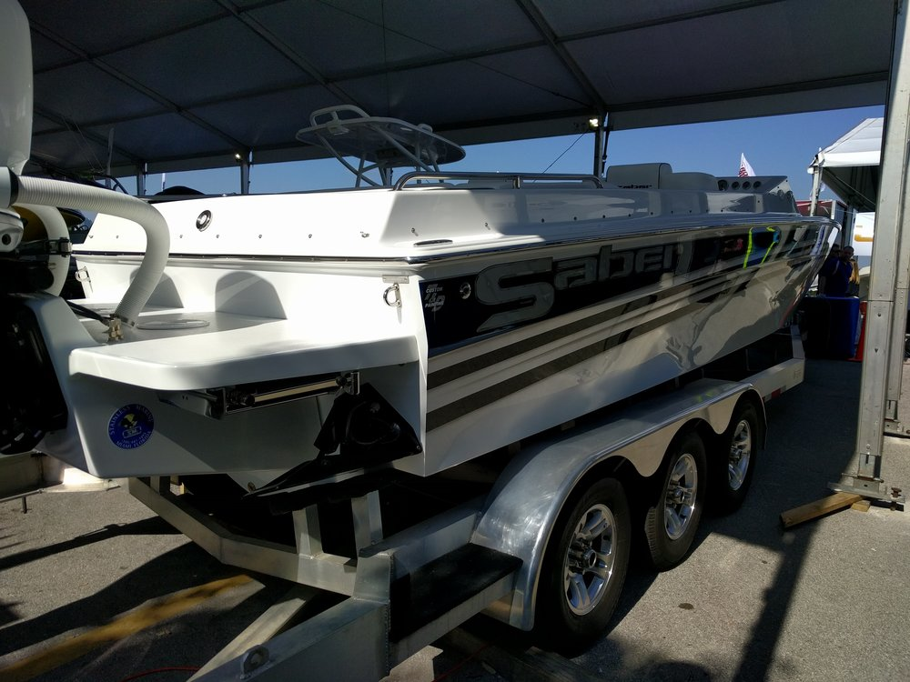 The Saber Marine 28 Offshore utilizes a Stainless Marine bracket for a clean look and a functional platform. Notice the access panel and hidden ladder, very functional.