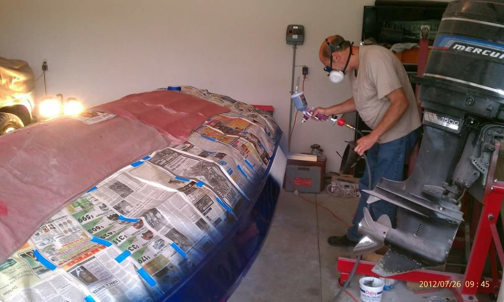 Paint - Will's Dad spraying the Interlux Perfection, dark blue stripes.