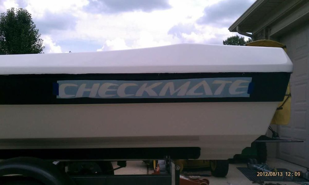 The modern Checkmate logo stenciled in on the new paint job, a modern touch.