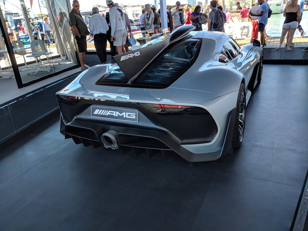 On the dock of the Cigarette Racing display at the Miami boat show, the AMG Project One car. The air inlet on the roof, flows into the shark fin, leading to the Formula 1 based exhaust design.