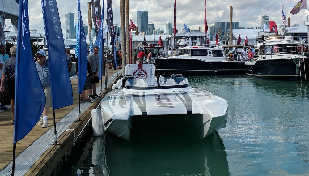 The Fountain 32' Sport Cat. Some of these hulls are starting to look very similar, curved windscreen, similar beam and a low profile swept back transom. This is a design Fountain acquired, not an original design.