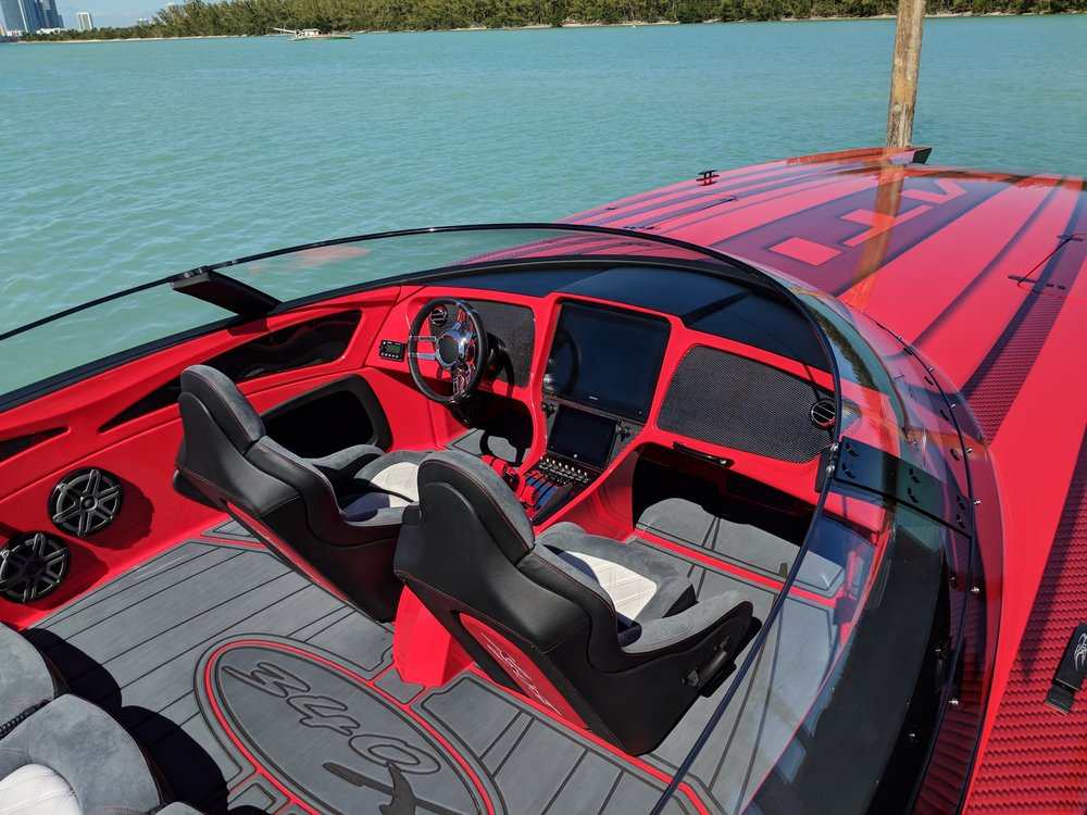 Practical family hauler here, seats 6. Way more practical than a Ferrari anyway. The MTI 340X has a phenomenal fit and finish with SeaDek flooring and digital screens.