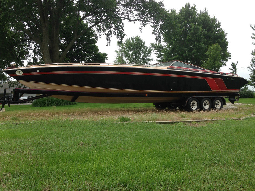 A Chris Craft 390, a descendant of the Excalibur design. You could put lots of stuff in that bow.