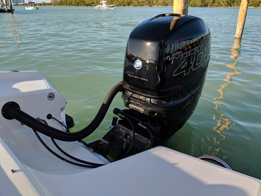 Notice the steering, clean rigging and integrated unit are an improvement over remote rams. Not quite as slick as the latest integrated systems from Evinrude or Yamaha, but nice.
