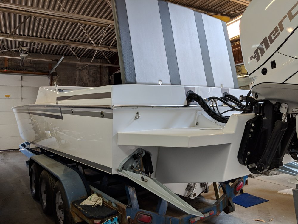 When executed properly, an outboard conversion can look really clean, even factory OE clean like this restored Sutphen with twin Mercury Verados.