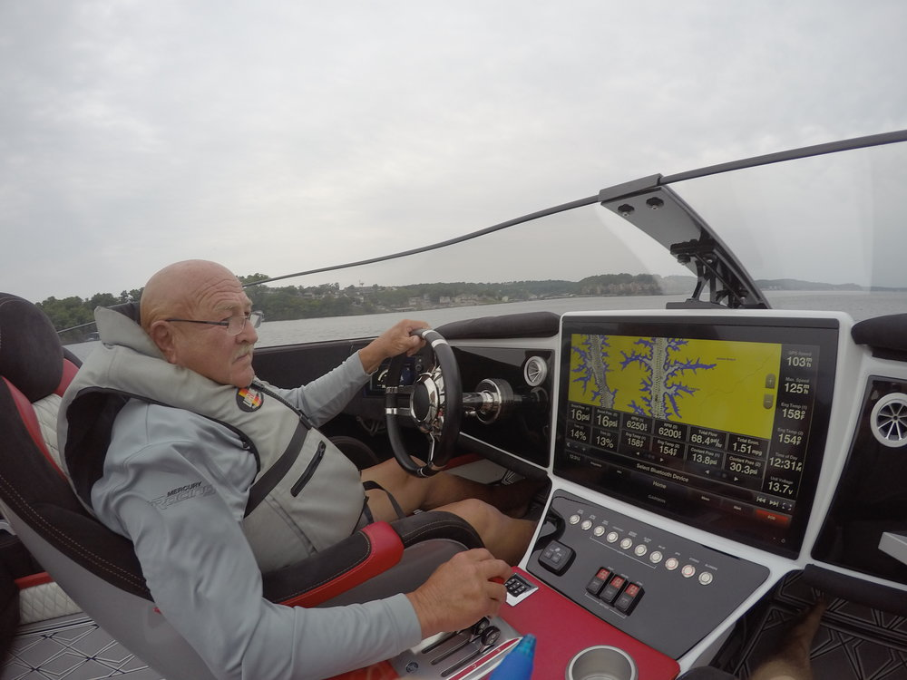 """Bob Teague, getting ready to teach the Mercury Racing 400Rs a lesson, at the wheel of the Wright Performance 360. """"Feels like a race boat"""" he said."""
