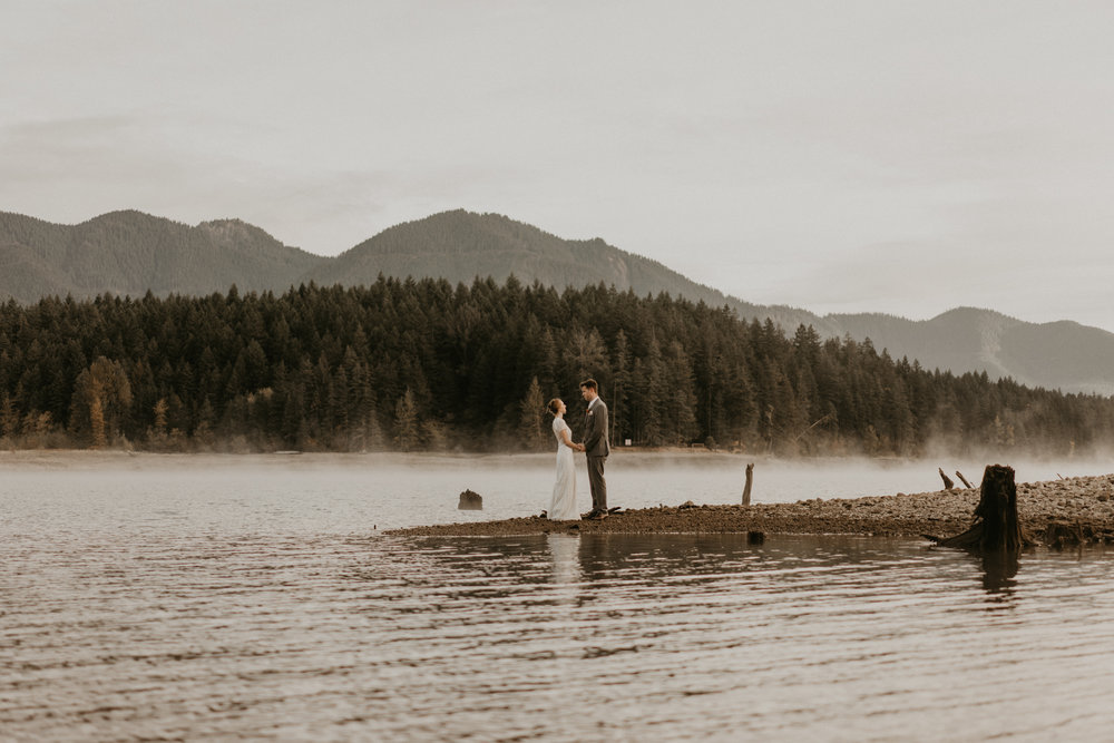 Bride and groom enduring the cold for their Lake Cushman elopement