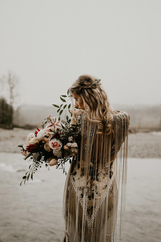 Rue de seine bridal boho wedding dress in the rain near Mount Rainier National Park