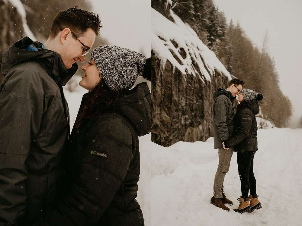 Romantic snow winter engagement photos by Snoqualmie Pass