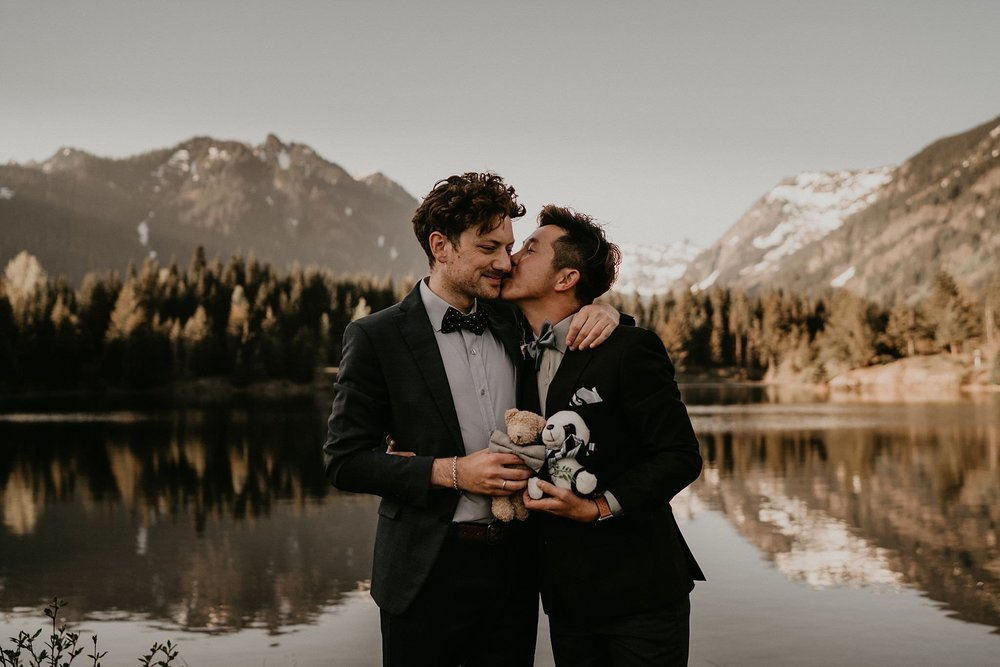 Intimate moment of gay couple married at Gold Creek Pond near Seattle