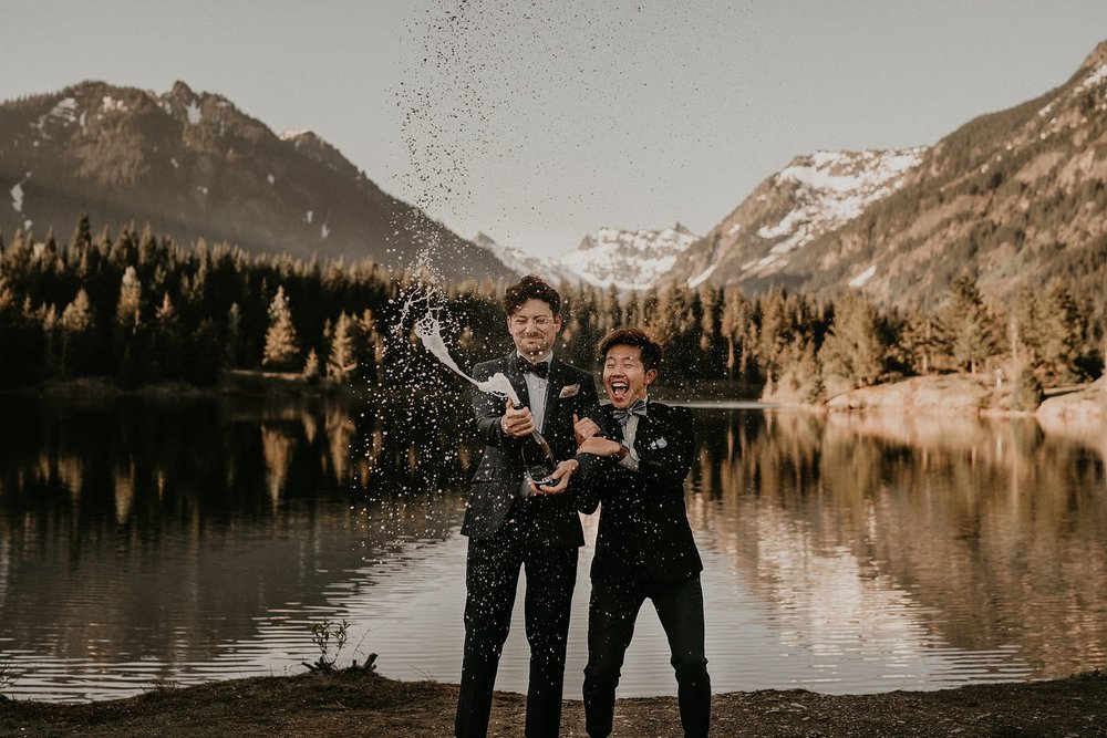 Popping champagne to celebrate marriage by Gold Creek Pond