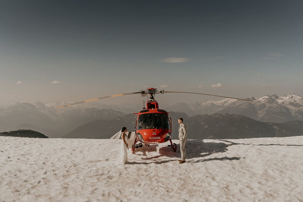 Jinza bridal wedding dress on top of whistler mountain in the snow for elopement