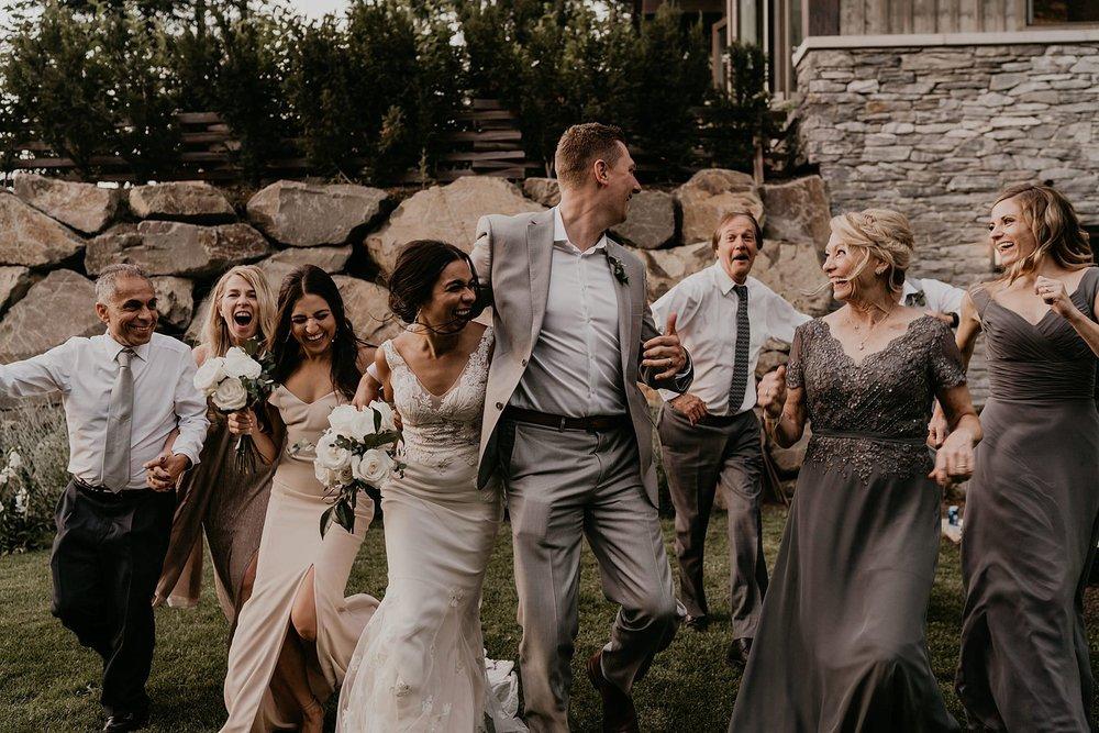 Fun group wedding photo running in whistler Canada