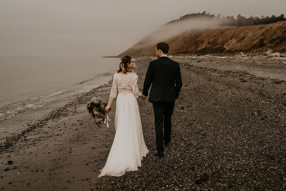 Intimate moment of bride and groom on whidbey island near olympic national park for their intimate wedding