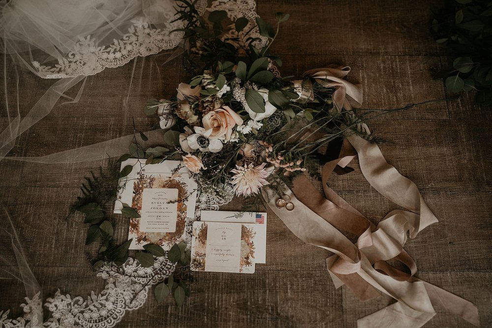Flat lay detail photos of blush invitations