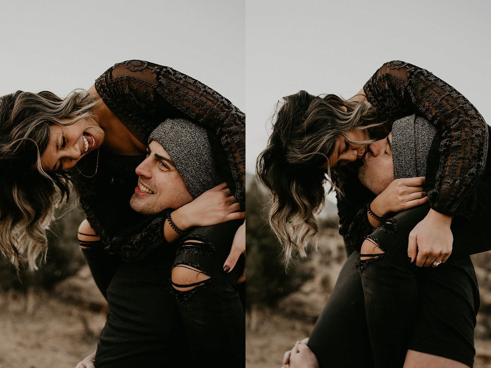 Couple kissing for authentic moments during their adventure at Joshua Tree National Park