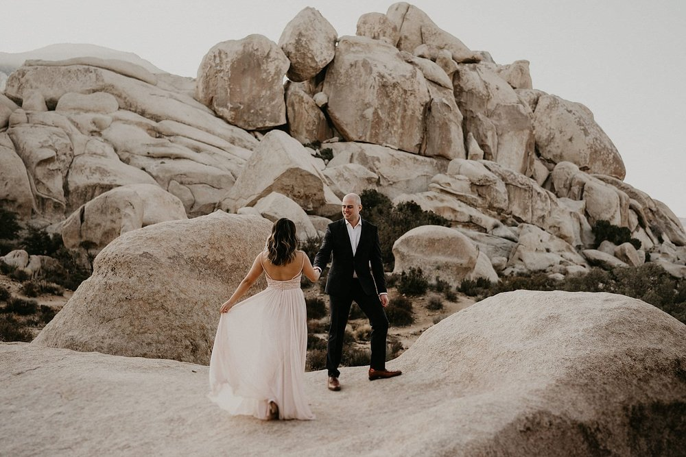 Couple looking majestic under the sun for their elopement wedding day at Joshua Tree National Park