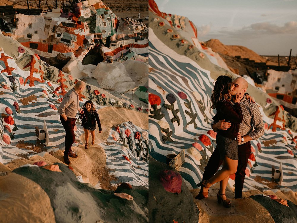 Climbing salvation mountain for their engagement photos