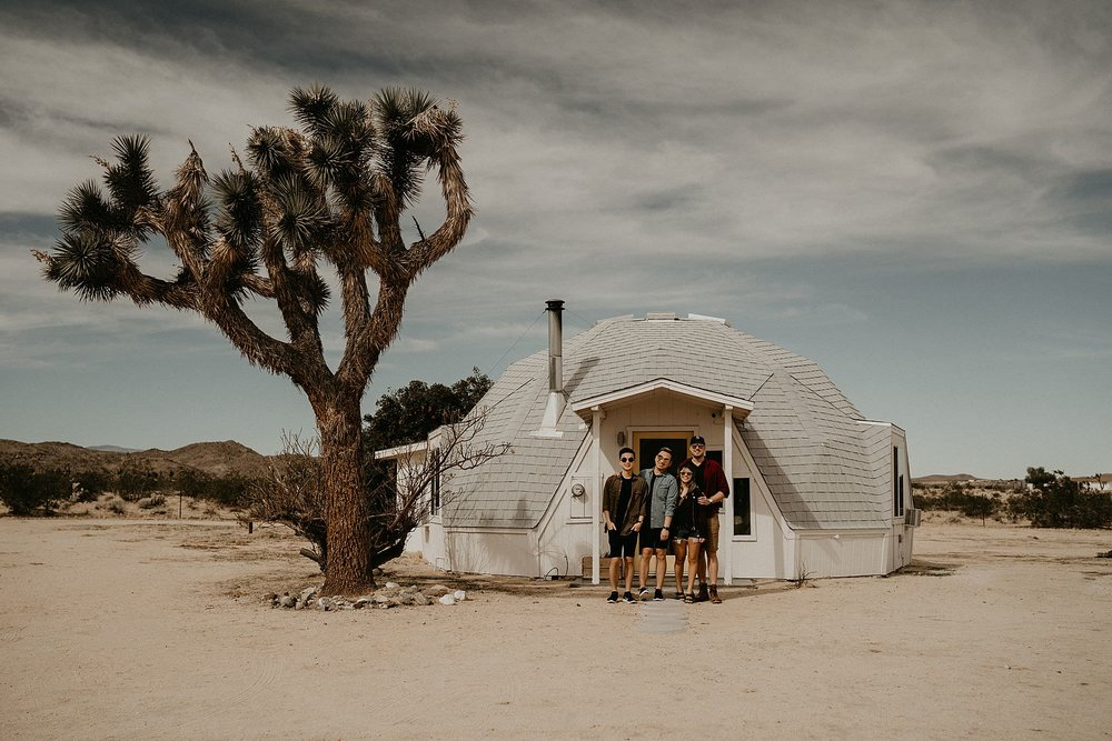 Henry Tieu Photography is being candid with couple at Dome in the desert near Joshua Tree national park