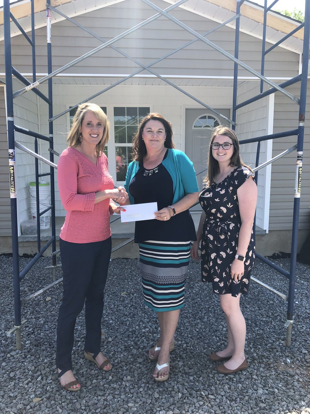 Tammy K. Johnson and Natalie McNair, Habitat for Humanity, accepted a check from Lisa Mantooth (Center), WACKER representative.