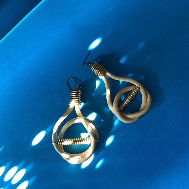 Shade of *azure* Shop our leather lightbulb earrings in sand. www.eluke.co// #wearyourbold